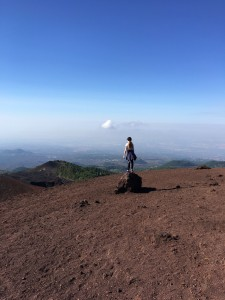 Girl standing on top of mount Etna